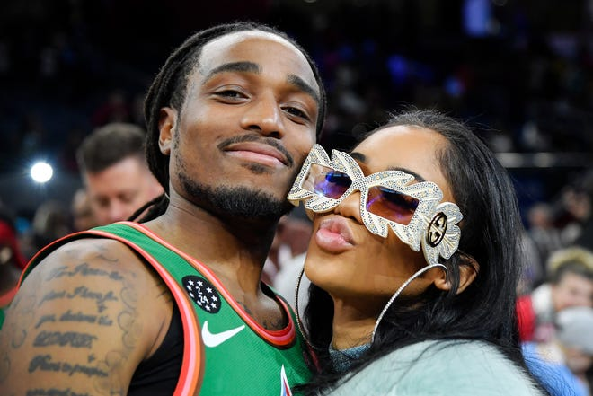 Quavo poses for a photo with Saweetie after the NBA All-Star Celebrity Game.