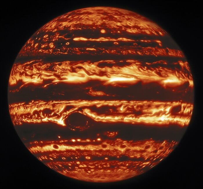 This infrared view of Jupiter was created from data captured on 11 January 2017 with the Near-InfraRed Imager (NIRI) instrument at Gemini North in Hawaiʻi, the northern member of the international Gemini Observatory, a Program of NSF's NOIRLab. It is actually a mosaic of individual frames that were combined to produce a global portrait of the planet.