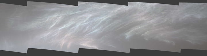 """NASA's Curiosity Mars rover spotted these iridescent, or """"mother of pearl,"""" clouds on March 5, 2021, the 3,048th Martian day, or sol, of the mission. Seen here are five frames stitched together from a much wider panorama taken by the rover's Mast Camera, or Mastcam."""