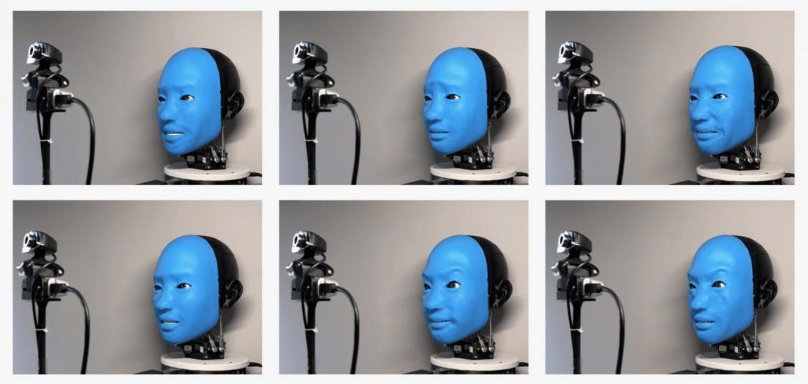 The robot mirrors human facial expressions captured by a camera.