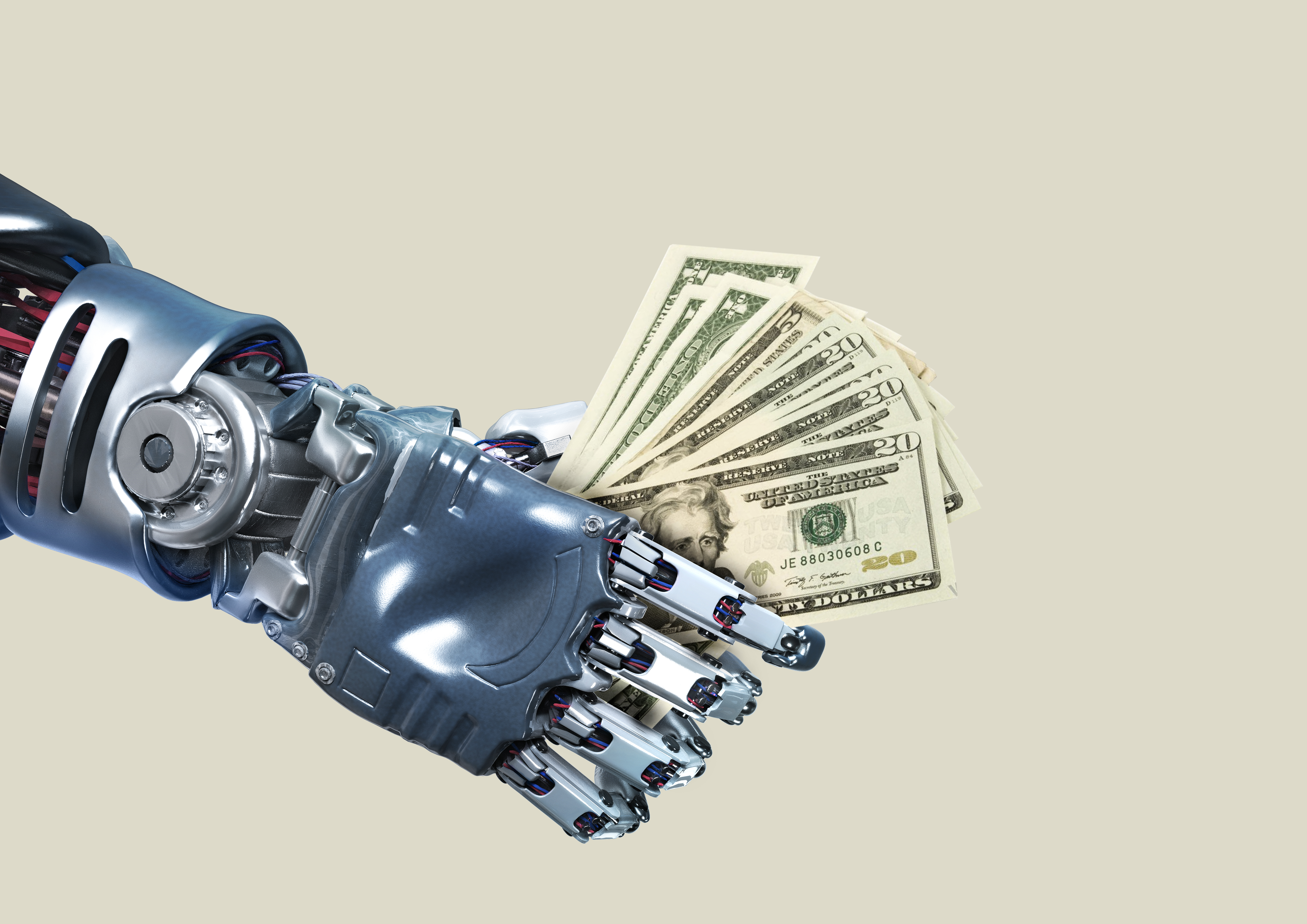 Image of a robot hand holding a fistful of cash to represent funding for robotics startups.