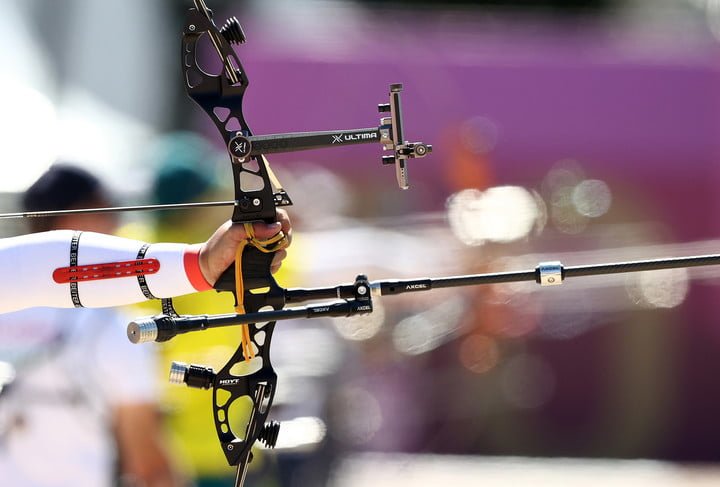An athlete aims his bow during the men's individual archery ranking round held in Yumenoshima Park as part of the 2020 Summer Olympic Games.