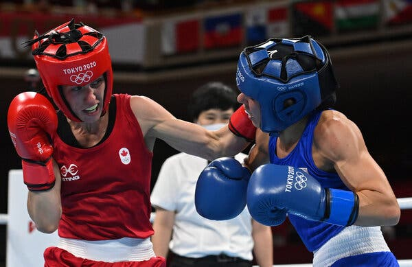 Mandy Bujold of Canada, left, in action against Nina Radovanovic of Serbia.