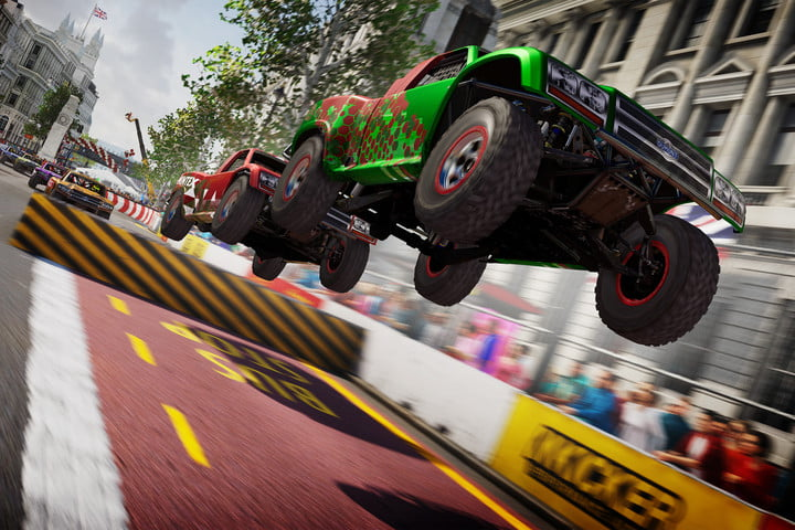 Two cars launch off a jump in Grid Legends.