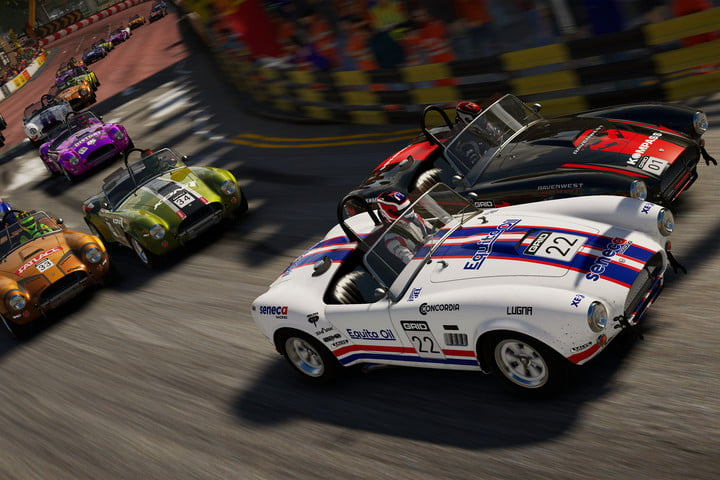 Several cars zip around a bend in Grid Legends.