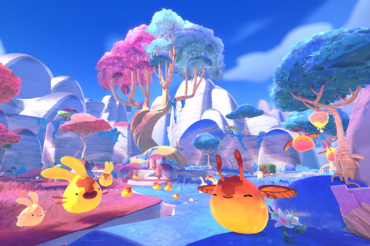Slimes happily bounce around in the wild in Slime Rancher 2.