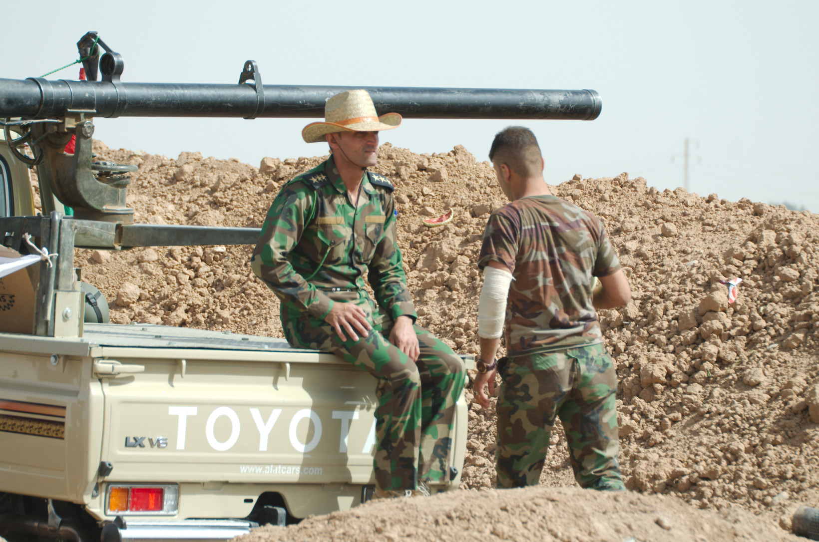 A Toyota pick up truck is used by soldiers